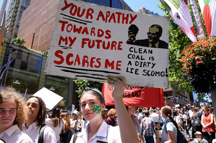 A student holds a placard demanding action on climate change in Sydney on Nov 30, 2018. Australia Prime Minister Scott Morrison has criticised the protests, saying he wanted more learning and less activism in schools.