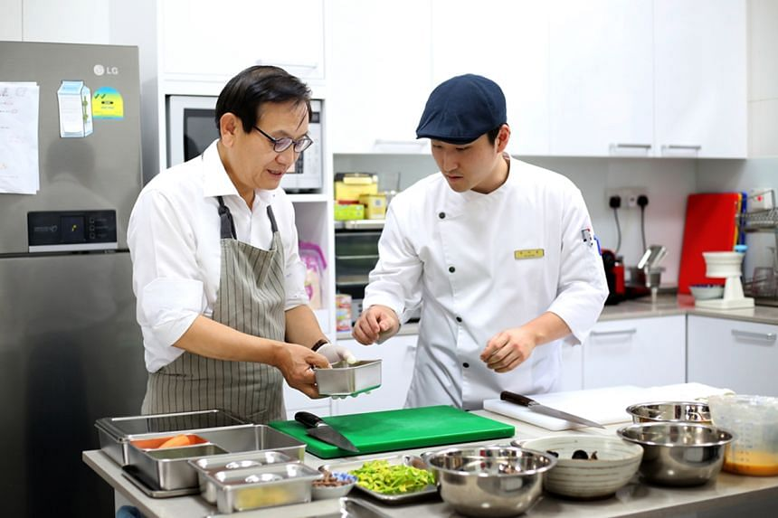 South Korean Ambassador to Singapore Ahn Young-jip (left) preparing traditional Korean rice dish bibimbap for the filming of Mission:SG.