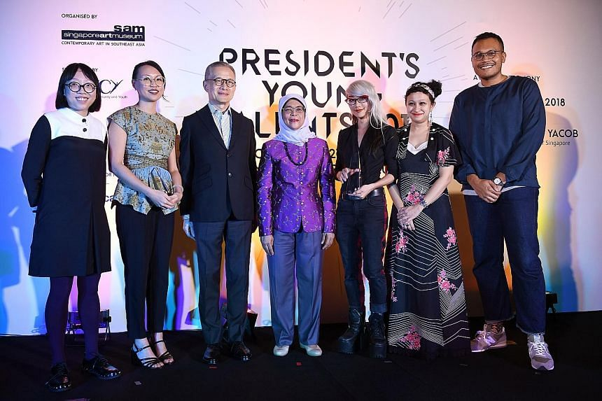 President Halimah Yacob with (from left) Debbie Ding, Yanyun Chen, Singapore Art Museum chairman Edmund Cheng, Weixin Quek Chong, Zarina Muhammad and Hilmi Johandi at the ceremony last night. The jury panel said the installation by Chong, who won the