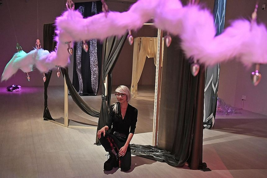 Visual artist Weixin Quek Chong, 30, received the $20,000 Grand Prize from President Halimah Yacob at the President's Young Talents awards yesterday at the Singapore Art Museum (SAM) at 8Q. She was one of five finalists for the seventh edition of the