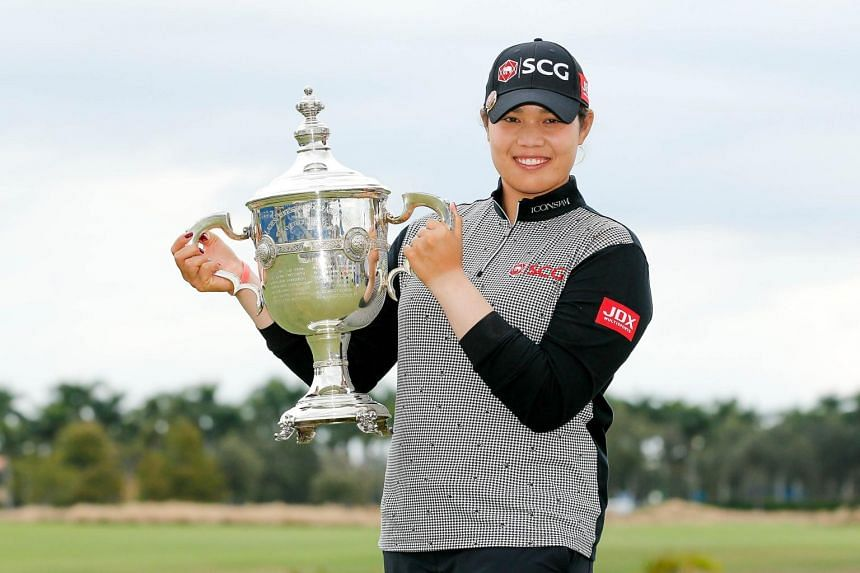 Ariya Jutanugarn poses with the Rolex Player of the Year trophy after the final round of the LPGA CME Group Tour Championship at Tiburon Golf Club in Florida, on Nov 18, 2018.