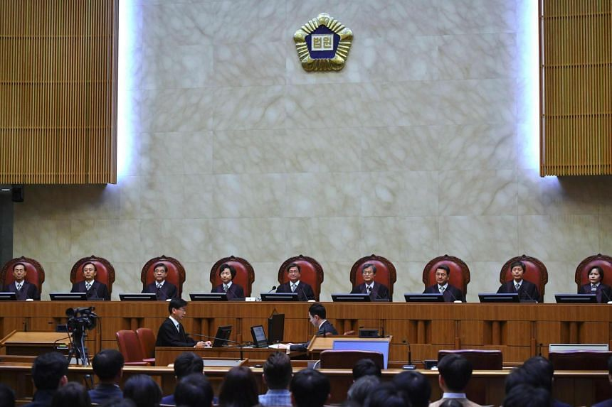 South Korea's Supreme Court chief justice Kim Myeong-su (centre) delivers the court's ruling on a conscientious objector's conviction of refusing to do mandatory military service, in Seoul, on Nov 1, 2018.