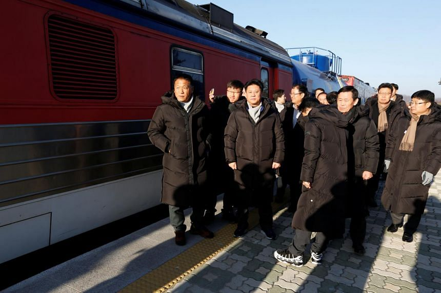 South Korean experts prepare to travel across the border into North Korea at Dorasan station in Paju, South Korea, on Nov 30, 2018.