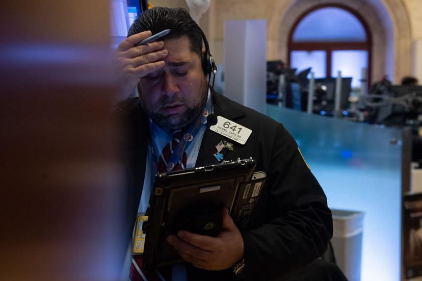 Traders work on the floor at the closing bell of the Dow Industrial Average at the New York Stock Exchange, on Nov 21, 2018.
