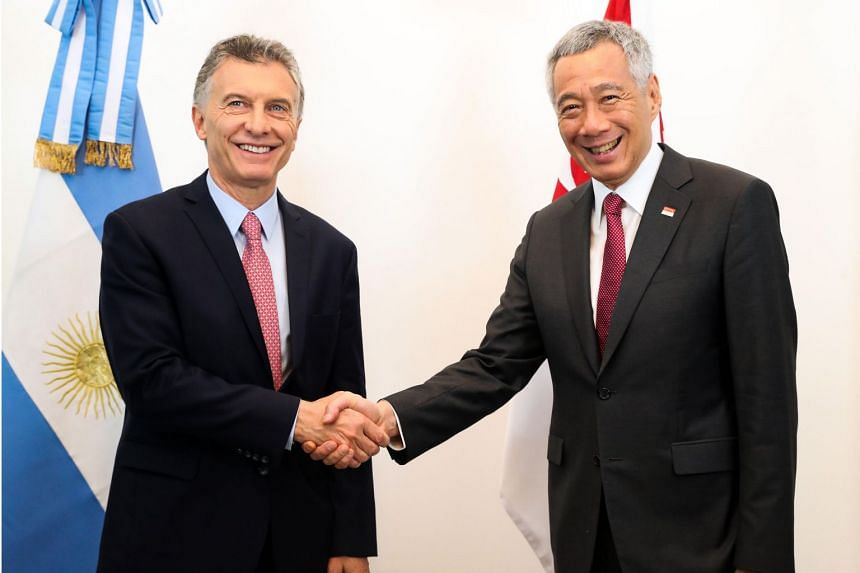 Argentina's President Mauricio Macri (left) welcoming Singapore's Prime Minister Lee Hsien Loong on arrival in Buenos Aires on Nov 29, 2018.