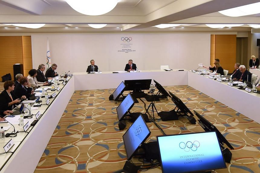 International Olympic Committee (IOC) President Thomas Bach (centre) and other executives attend at the IOC Executive Board meeting in Tokyo, on Nov 30, 2018.