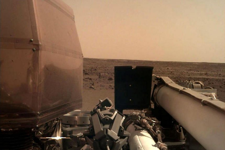 The Instrument Deployment Camera, located on the robotic arm of Nasa's InSight lander, took this image of the Martian surface the day the spacecraft touched down on the Red Planet, on Nov 26, 2018.