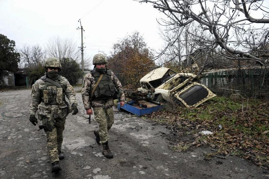 Ukrainian soldiers patrol in the front line with Russia-backed separatists in the small city of Shyrokyne, 25 km from Azov Sea port of Mariupol, on Nov 28, 2018.