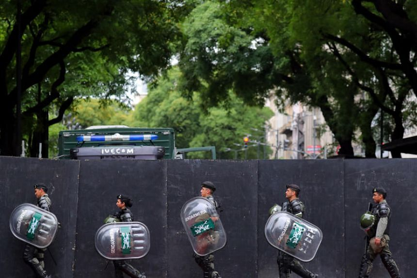 Members of Argentina's National Gendarmerie march outside a secured area in a neighbourhood, ahead of the Group 20 summit, in Buenos Aires, Argentina, on Nov 29, 2018.