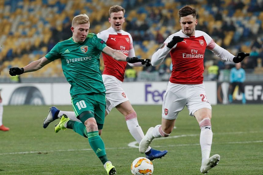 e1a0c6595 Vladyslav Kulach (left) of Vorskla and Carl Jenkinson (right) of Arsenal in