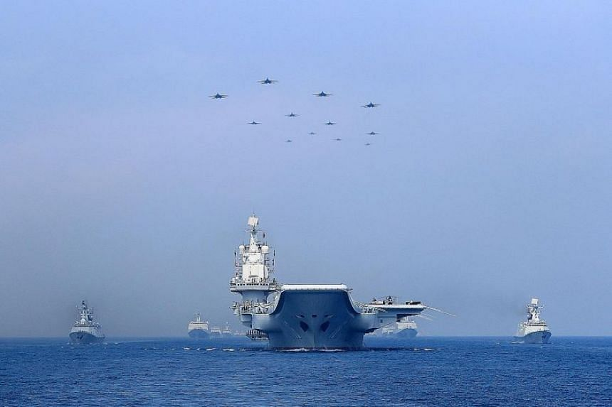 File photo of Chinese warships and jets taking part in a military display in the South China Sea in April.