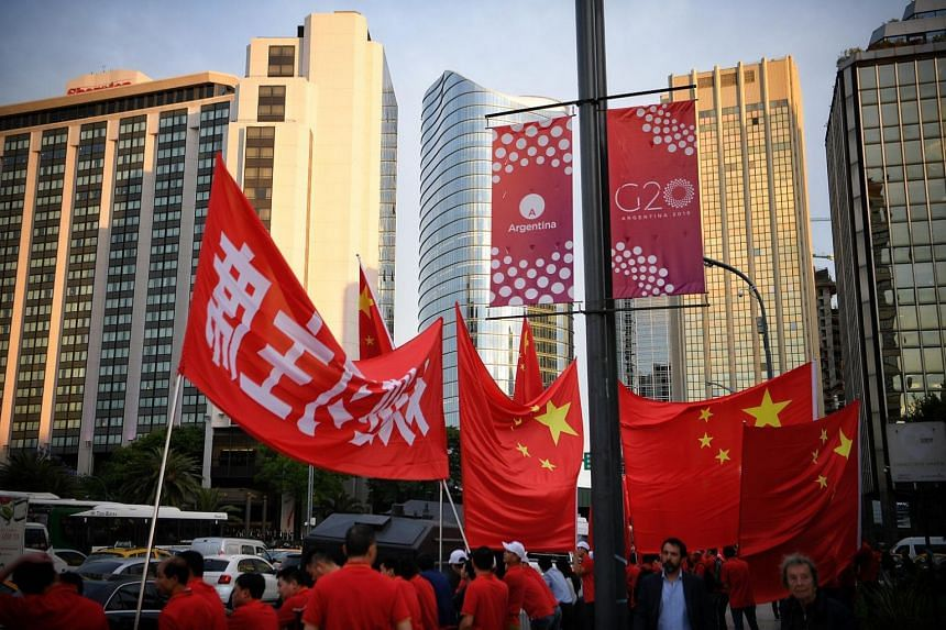Chinese citizens await the arrival of Chinese President Xi Jinping in downtown Buenos Aires ahead of the G-20 summit, on Nov 29, 2018.