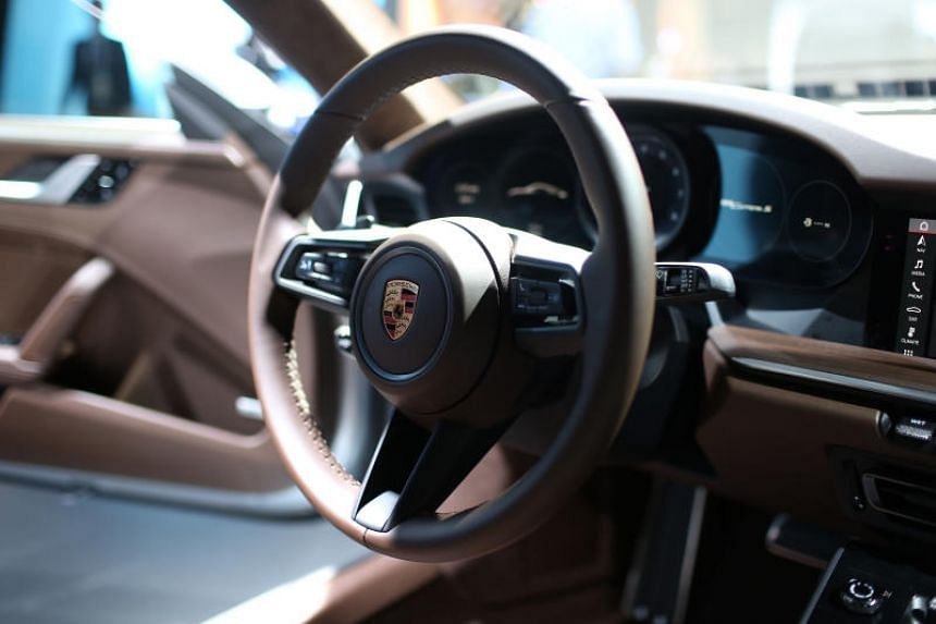 A Singaporean man driving a Porsche was arrested and charged with reckless driving causing injury after hitting a police officer at a speed checkpoint on Thursday morning (Nov 29). PHOTO: BLOOMBERG