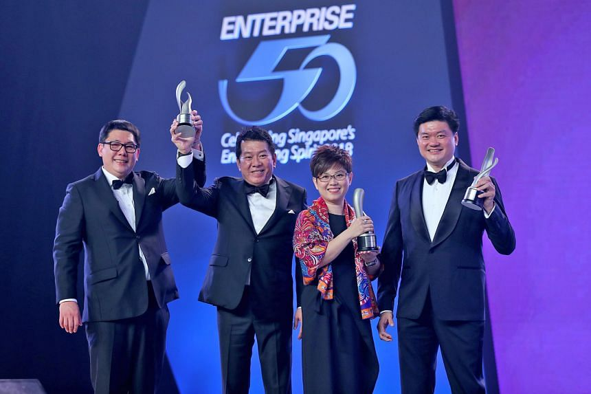 Representing the top three winners at the Enterprise 50 Awards are (from left) Mr Jacob Gay and Mr Ng Keng Sing, directors at Midas NSSG International, Ms Phyllis Ong, group deputy chief executive officer at Armstrong Industrial Corporation, and Mr V
