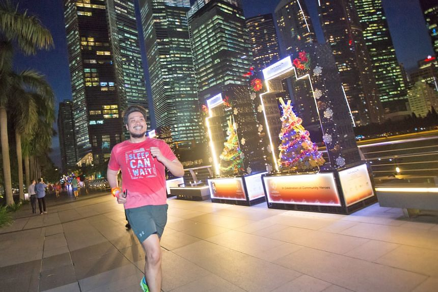 """Lawyer Darrell Low is a big Sundown Marathon fan. He says the good thing about the event is not having to worry about """"getting baked by the sun"""" but he still hopes it will not be too cloudy on race day."""