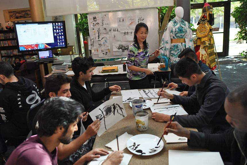 A Chinese brush painting class at the Confucius Institute at the Community College of Denver in Colorado. There are now 110 such institutes across the US, said the report. Their primary mission is to teach Chinese language and culture abroad.