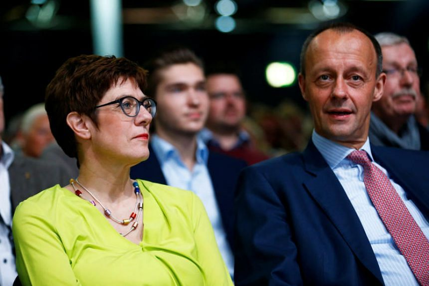 Christian Democratic Union candidates for the party chair Annegret Kramp-Karrenbauer and Friedrich Merz attend a regional conference in Duesseldorf, Germany, on Nov 28, 2018.
