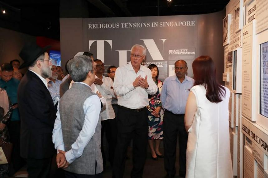 Emeritus Senior Minister Goh Chok Tong touring the Harmony in Diversity Gallery with religious leaders at the Ministry of National Development building on Nov 30, 2018.