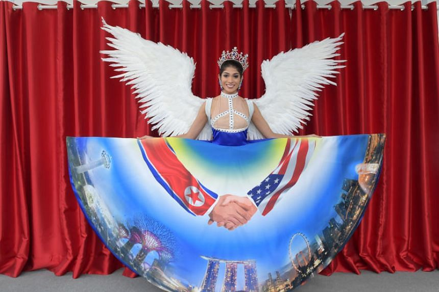 The costume, which was unveiled on Nov 29, 2018, featured a skirt digitally printed with a handshake - one arm features the North Korean flag and the other, the American flag - over the Singapore skyline.