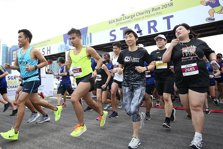 Charity run SGX Bull Charge raised more than $3.3 million for six beneficiaries - AWWA, Autism Association (Singapore), Community Chest, Fei Yue Community Services, HCSA Community Services and Shared Services for Charities - the highest amount in ove