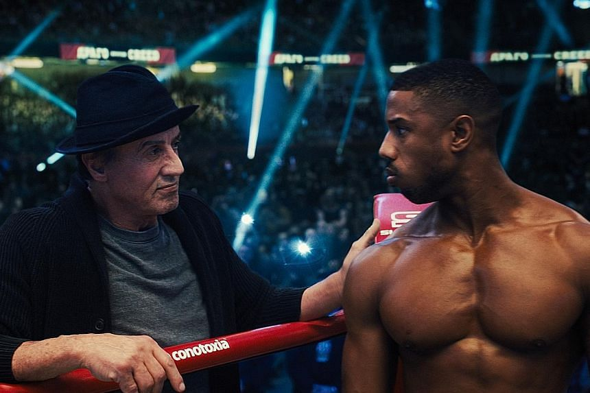 Sylvester Stallone (far left) plays Rocky, the trainer of boxer Adonis Creed, played by Michael B. Jordan (left).