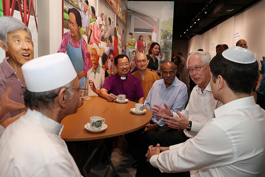 """""""I will promote, uphold and protect religious harmony for all,"""" wrote ESM Goh in a pledge during his visit to the Harmony in Diversity Gallery yesterday. ESM Goh Chok Tong chatting with religious leader Imam Habib Hassan Al-Attas (left) and IRO presi"""