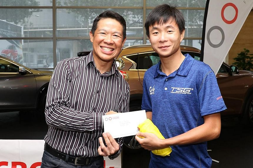 Singapore Cycling Federation president Hing Siong Chen (left) with Goh Choon Huat, winner of the OCBC Cycle Road Series Men's Open category. Jerseys were given out to the top riders in 22 categories at the OCBC Cycle Road and Mountain Bike Series awa