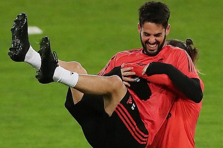Real Madrid's Isco (front) and Gareth Bale during training in Rome ahead of their midweek Champions League game against Roma. The media reported a falling-out between Isco, who was not even named on the bench, and coach Santiago Solari.