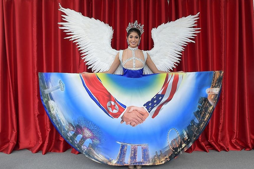 The Miss Universe Singapore costume - worn here by pageant winner Zahra Khanum - is based on the Trump-Kim summit theme. It has been called ugly by many netizens, who aimed their criticism at the designer.