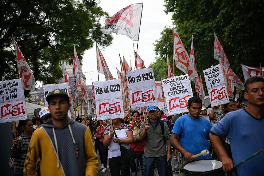 Supporters of the Workers' Socialist Movement protesting in Buenos Aires on Thursday ahead of the G-20 Leaders' Summit. The Global Governance Group, an informal group of 30 smaller states, said it welcomes recent efforts by the G-20 to uphold the rul
