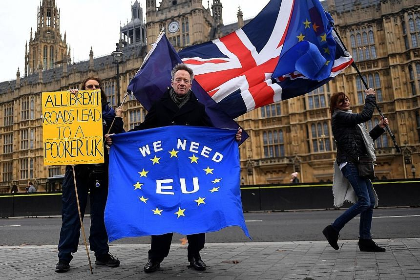 Pro-EU protesters making their stance known outside Parliament in London on Thursday. British MPs are set to vote on Prime Minister Theresa May's EU Brexit deal on Dec 11.
