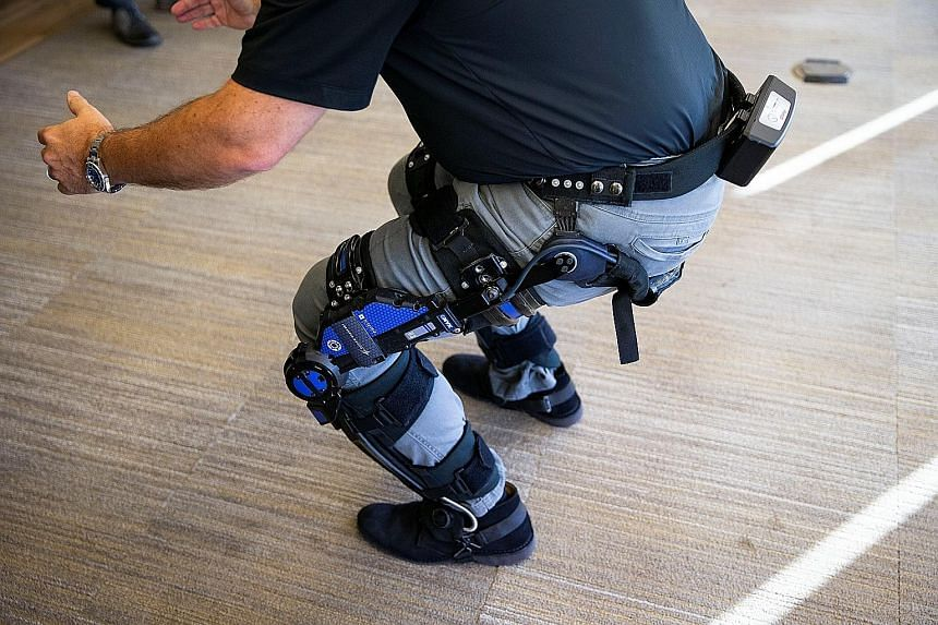 Mr Keith Maxwell, exoskeleton technologies manager at Lockheed Martin Missiles and Fire Control, demonstrating an exoskeleton in Washington on Thursday.