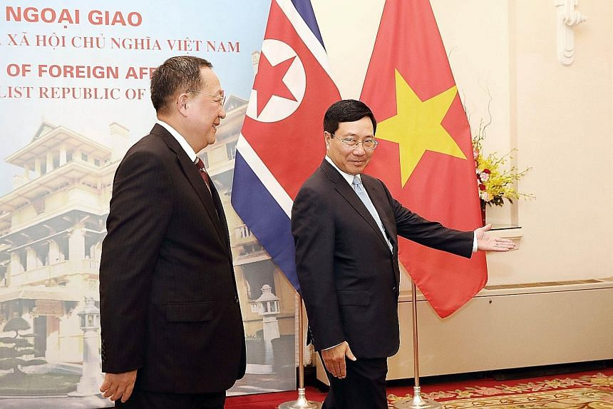 Vietnamese Foreign Minister Pham Binh Minh (near left) welcoming his North Korean counterpart Ri Yong Ho who started an official visit to Hanoi yesterday.