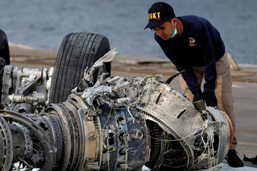 An Indonesian National Transportation Safety Commission official examines a turbine engine from Lion Air flight JT 610 at Tanjung Priok port in Jakarta, Indonesia, on Nov 4, 2018.