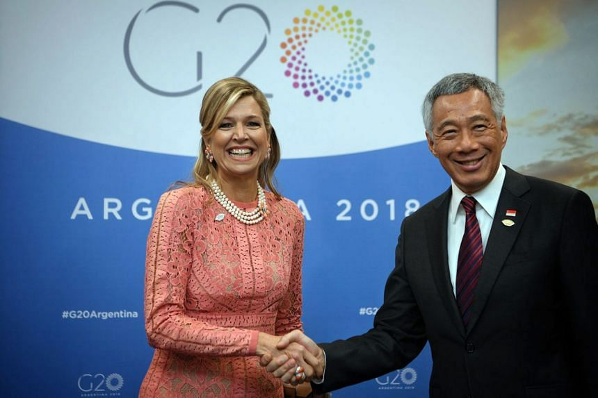 Prime Minister Lee Hsien Loong meets the Netherlands' Queen Maxima on the sidelines of the Group of 20 summit in Buenos Aires on Dec 1, 2018.