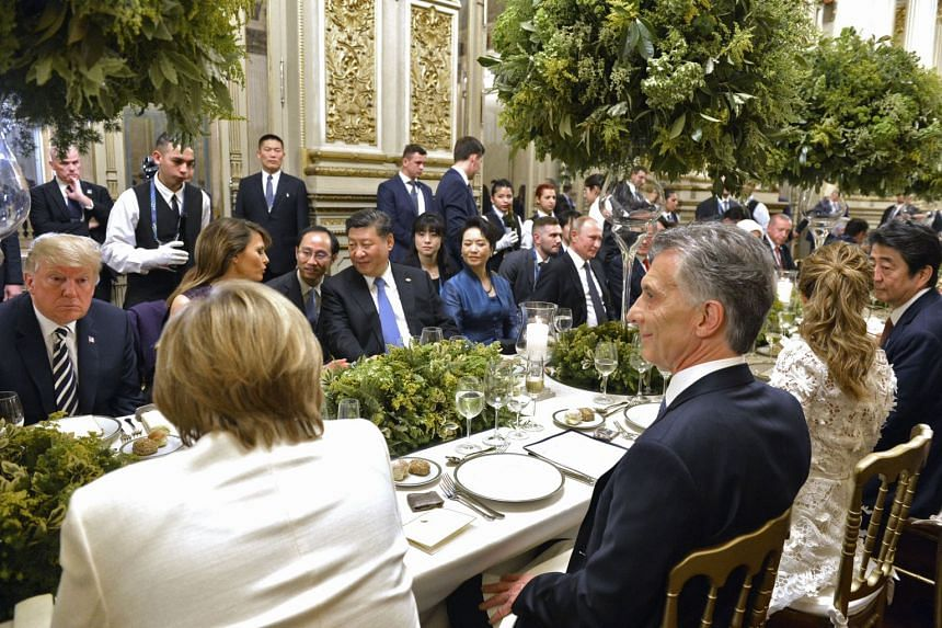 Group of 20 (G-20) leaders and their spouses at a banquet after a gala in Buenos Aires on Nov 30, 2018, on the sidelines of the G-20 summit.