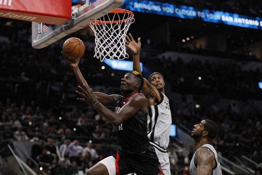 Houston Rockets centre Clint Capela shoots the ball past San Antonio Spurs small forward Dante Cunningham during their NBA game at AT&T Center in San Antonio on Nov 30, 2018.