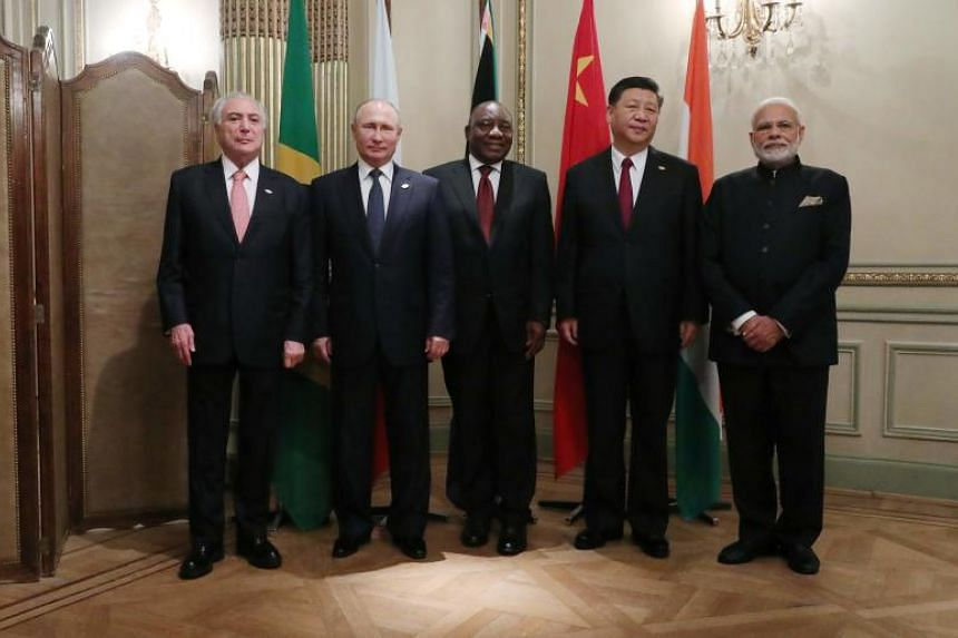 (From left) Brazil's President Michel Temer, Russia's President Vladimir Putin, South Africa's President Cyril Ramaphosa, China's President Xi Jinping and India's Prime Minister Narendra Modipose at a Brics Leaders' meeting on the sidelines of the G-