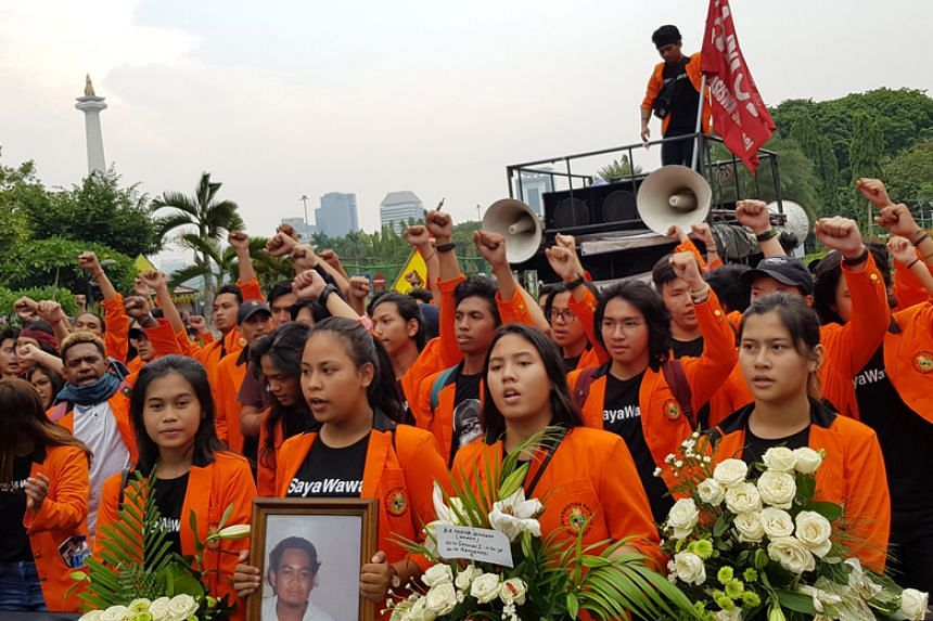 Atma Jaya University students protest in front of the State Palace in Jakarta on Dec 1, 2018, to commemorate the Nov 13 Semanggi I shooting 20 years ago.