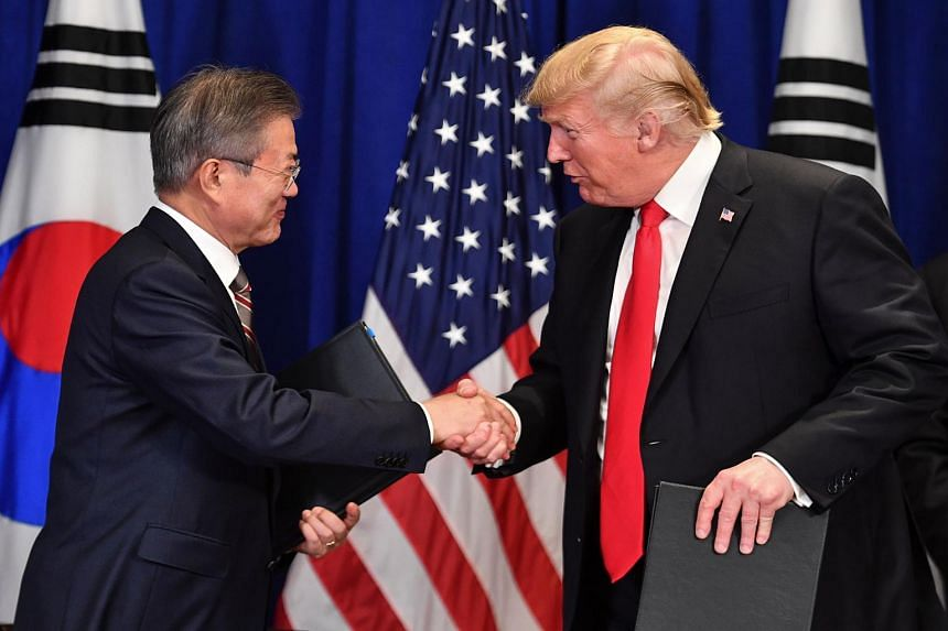US President Donald Trump and South Korean President MoonJae-in shake hands after signing a trade agreement at a bilateral meeting in New York, on Sept 24, 2018.
