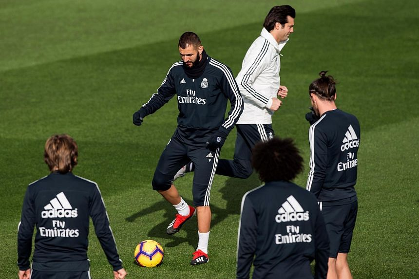 Real Madrid's Karim Benzema (centre) attends a training session held at the team's Valdebebas Sports City in Madrid, Spain, on Nov 30, 2018.