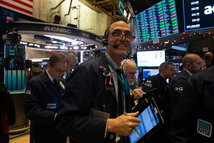 Traders work on the floor at the closing bell of the Dow Industrial Average in New York, on Nov 28, 2018.