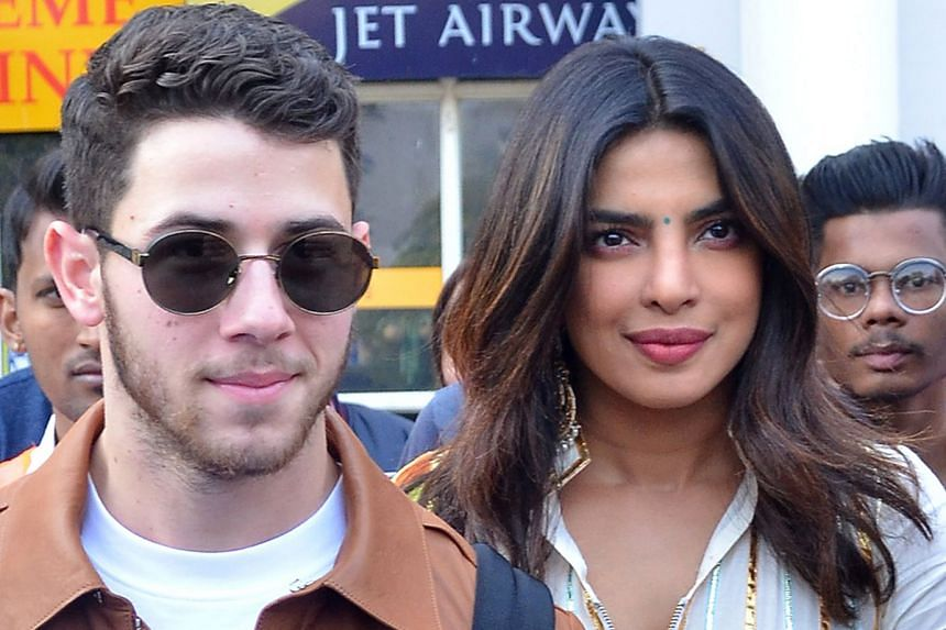 Singer Nick Jonas and Bollywood actress Priyanka Chopra arriving at the airport in Jodhpur, India, where they will host a party today and tie the knot tomorrow.