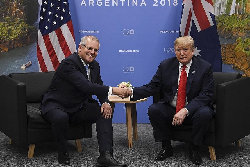 Australian Prime Minister Scott Morrison (left) with US President Donald Trump during the G-20 summit in Buenos Aires, Argentina, on Friday. Some experts said Mr Trump's truncated schedule represented a new phase in his unorthodox approach to statecr