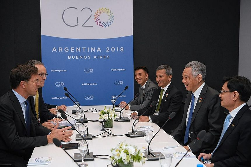 Left: PM Lee met his Italian counterpart Giuseppe Conte at the G-20 Summit yesterday. Right: On Friday, PM Lee, flanked by Foreign Minister Vivian Balakrishnan and Finance Minister Heng Swee Keat, met Dutch PM Mark Rutte and they discussed new areas