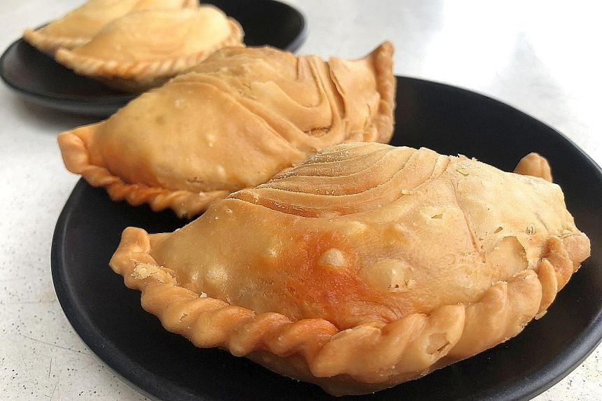 The Curry Chicken Puff at Soon Soon Huat Curry Puff has an addictively flaky pastry, which houses a warm, comforting filling.