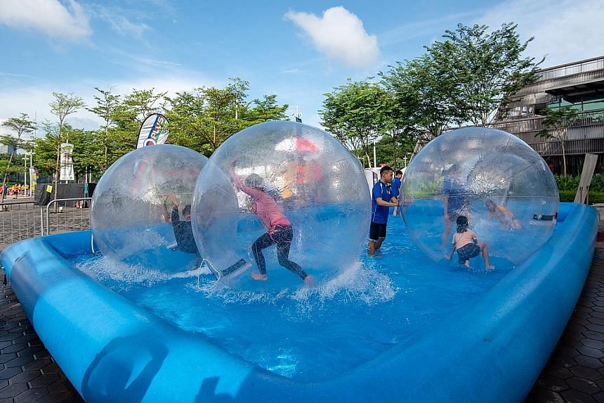 Christmas lights went up at the Singapore Sports Hub yesterday, as it ushered in the festive season in a big way. On the first of a two-day Community Play Day weekend, visitors participated in a host of activities including carnival games such as a b