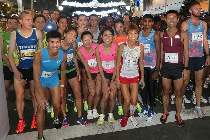 Two of Singapore's top long-distance runners, Ashley Liew and Evan Chee, with other elite athletes at the start line of last year's Standard Chartered Singapore Marathon.