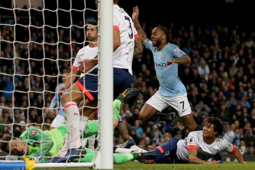 Manchester City's Raheem Sterling celebrates scoring during the English Premier League soccer match between Manchester City and Bournemouth at the Etihad Stadium in Manchester, Britain, on Dec 1, 2018.