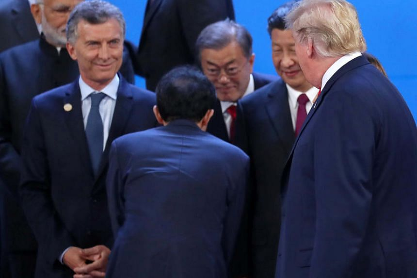 US President Donald Trump and Chinese President Xi Jinping are seen during the G20 summit in Buenos Aires, Argentina, on Nov 30, 2018.